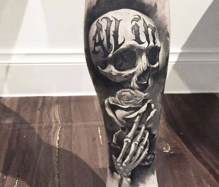Black skull tattoo by Benjamin Laukis