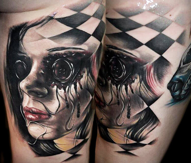 Face tattoo by Benjamin Laukis