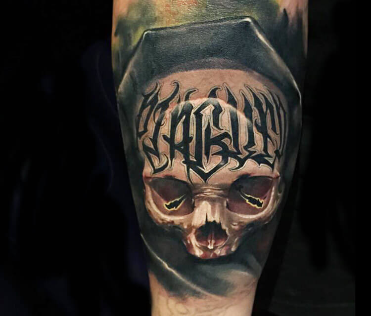 Skull and letters tattoo by Benjamin Laukis