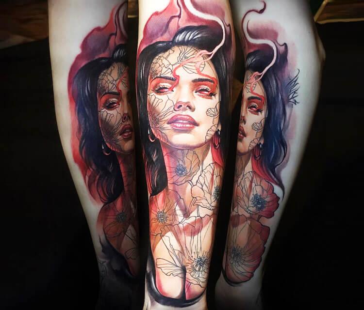 Woman tattoo by Benjamin Laukis