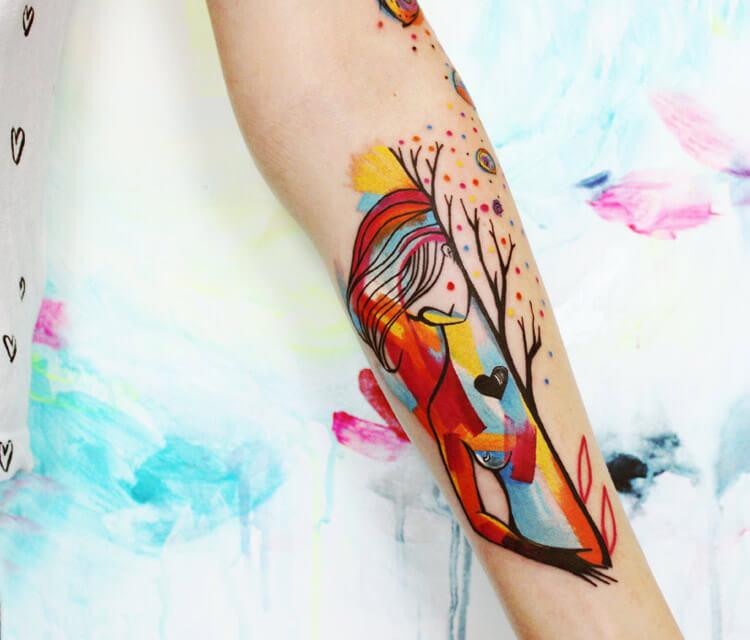 Woman in tree tattoo by Bumpkin Tattoo