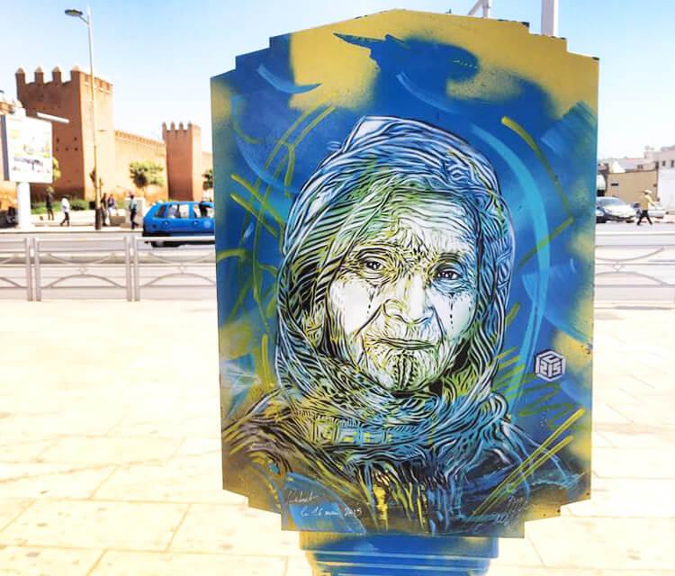 Old woman streetart portrait by C215