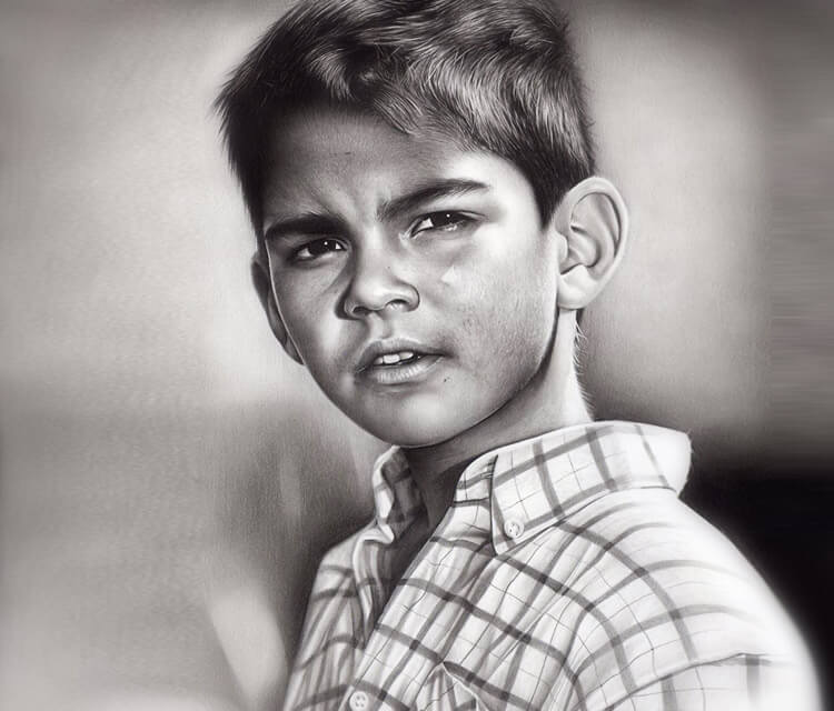 Boy in checkered shirt drawing by Charles Laveso