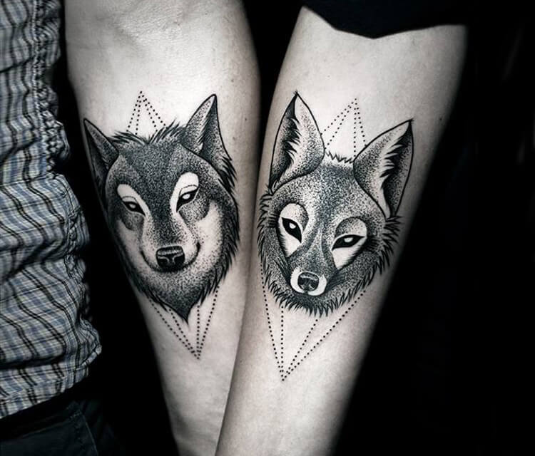 Wolf and Fox dotwork tattoo by Kamil Czapiga