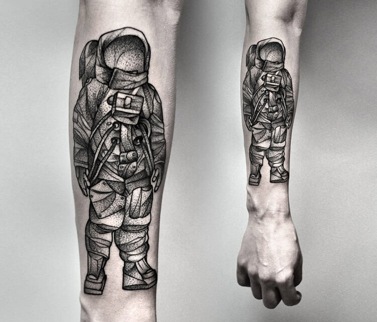 Cosmonaut dotwork tattoo by Kamil Czapiga