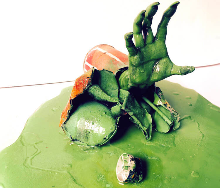 Green hand sculptures by Lukas Lukero Art