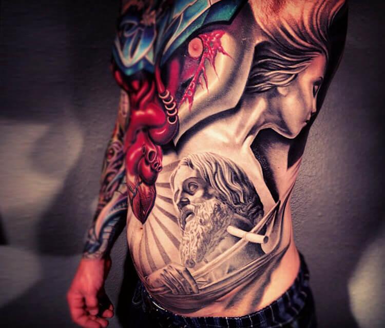 Religiuos ribs tattoo by Nikko Hurtado
