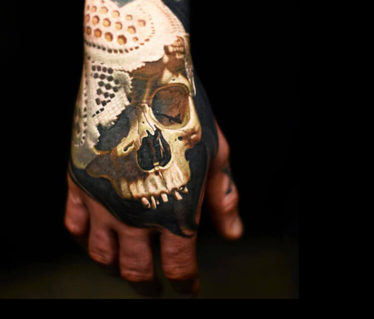 Skull hand tattoo by Nikko Hurtado