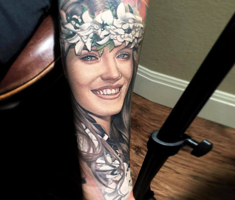 Woman portrait tattoo by Nikko Hurtado