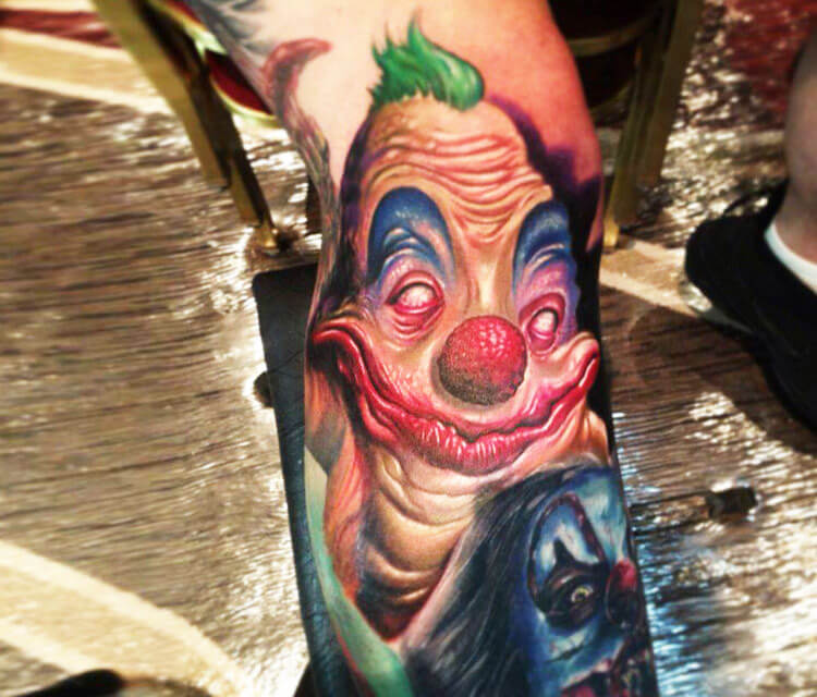 Horror clown portrait tattoo by Paul Acker