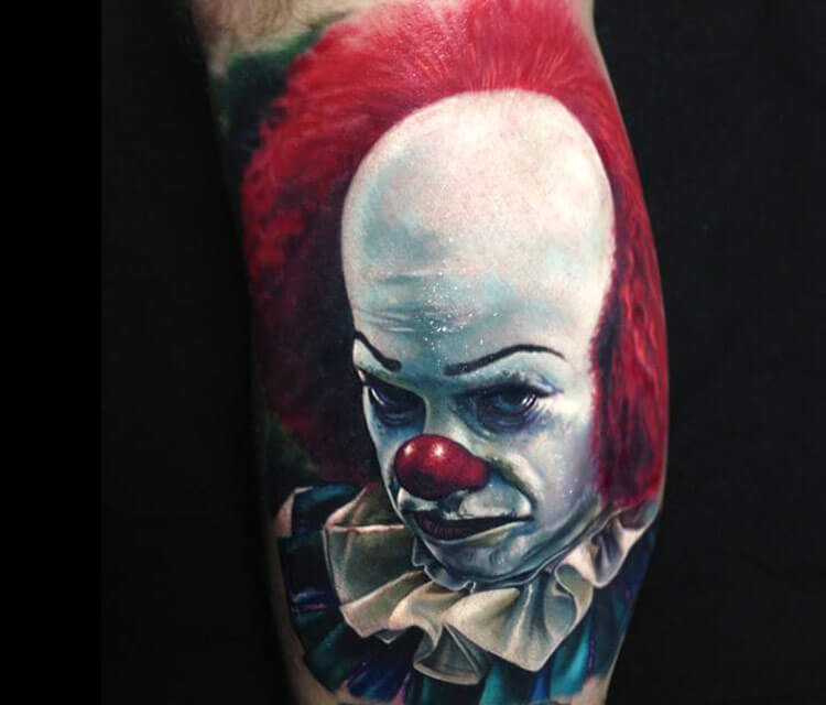 Realistic clown portrait tattoo by Paul Acker
