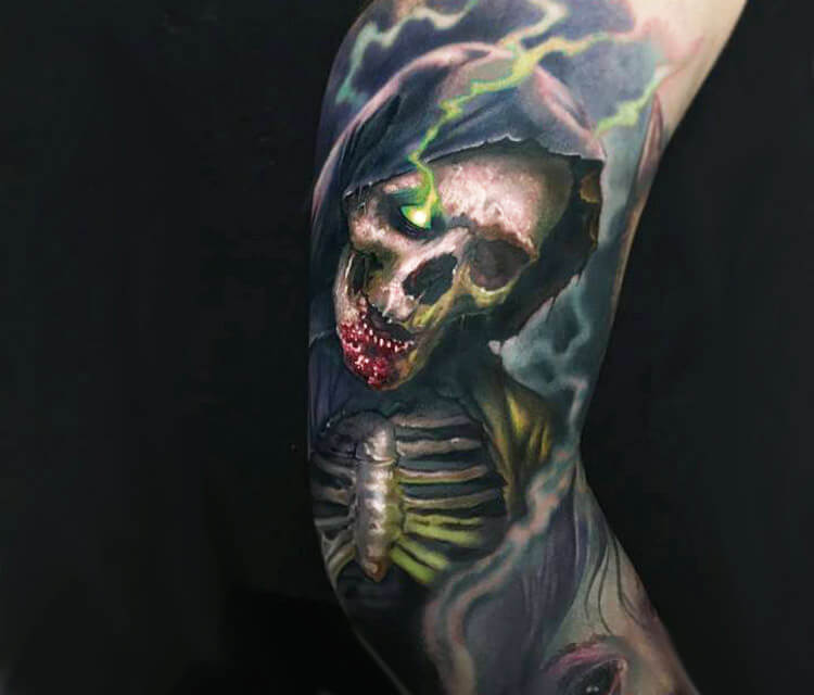 Ghoul skull tattoo by Paul Acker