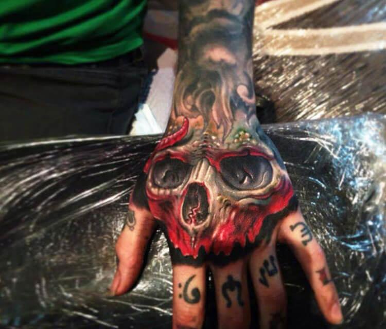 Hand skull tattoo by Paul Acker