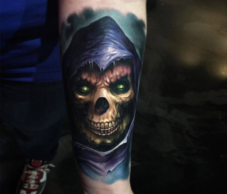 Ripper skull tattoo by Paul Acker