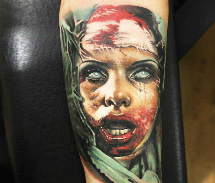 Bloody face tattoo by Sergey Shanko