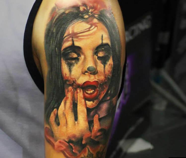 Horror clown tattoo by Sergey Shanko