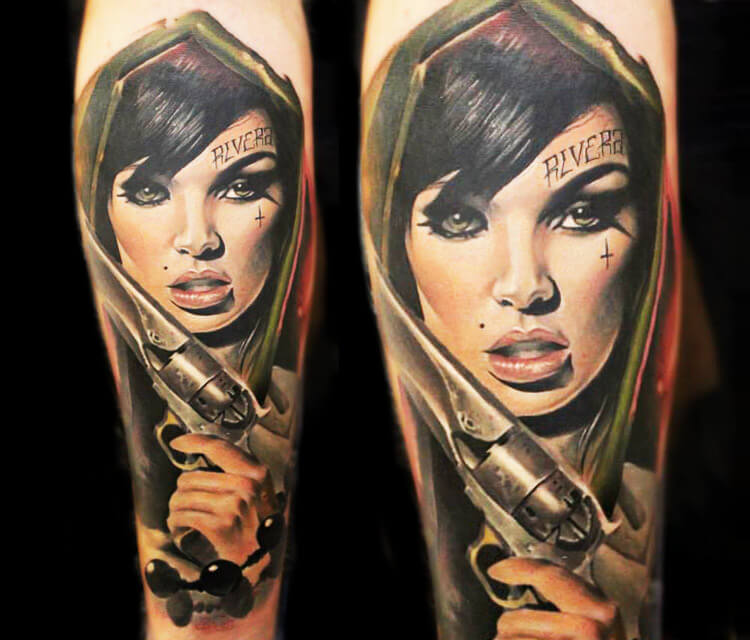 Woman with gun tattoo by Sergey Shanko