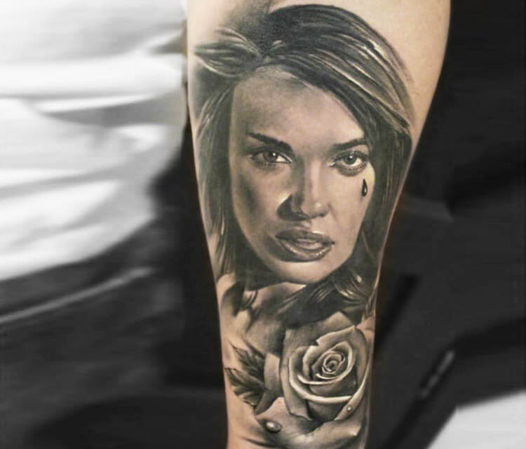 Woman with rose tattoo by Sergey Shanko