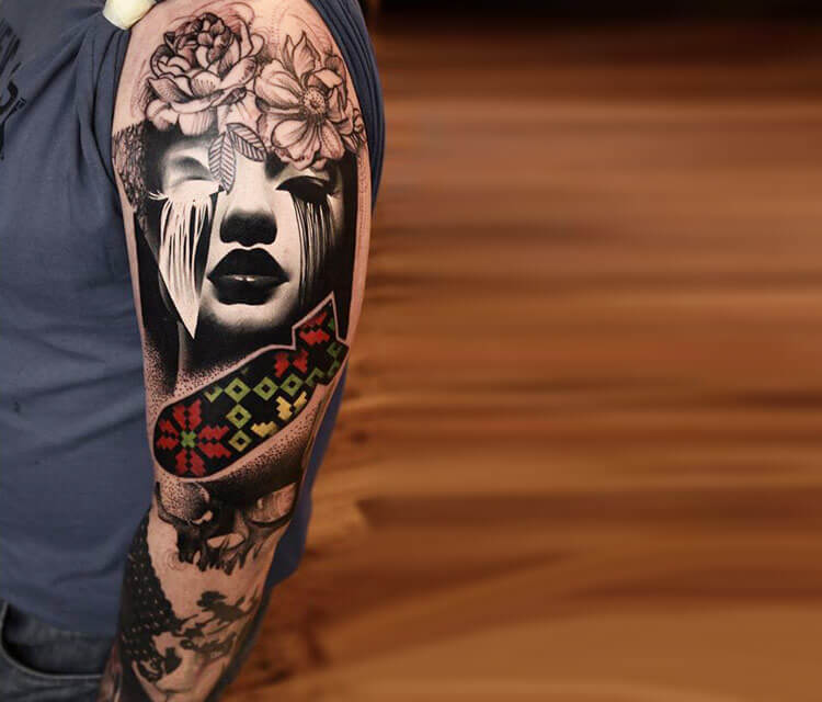 Face and atom bomb tattoo by Timur Lysenko