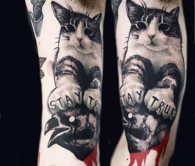 Stay true cat tattoo by Timur Lysenko
