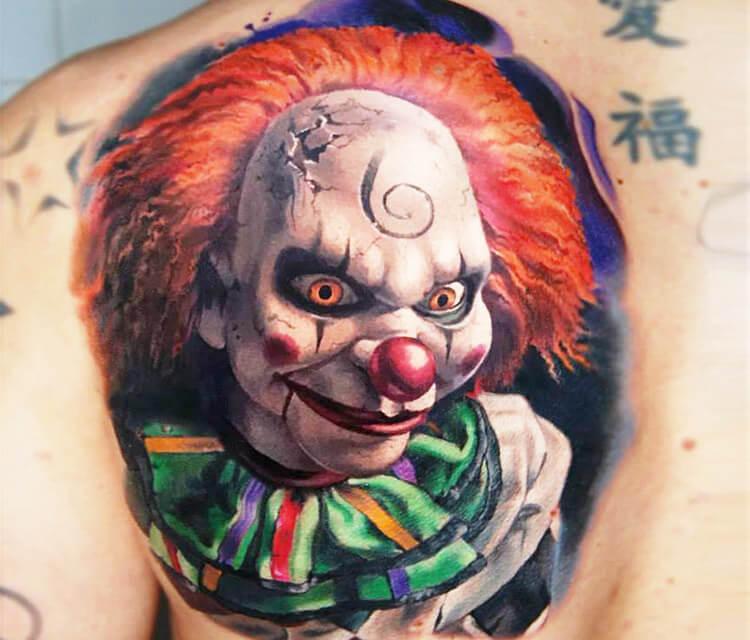 Clown face tattoo by Valentina Ryabova