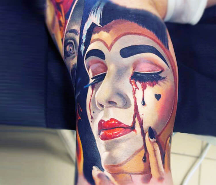 Clown face tattoo by Valentina Ryabova