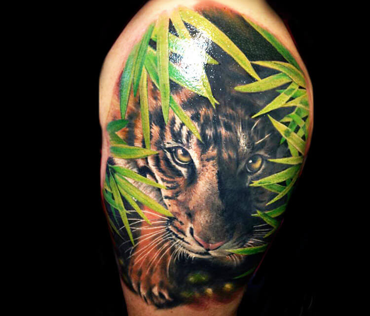 Little Tiger tattoo by Zsofia Belteczky